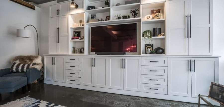 Keener white, modern entertainment center with sitting space