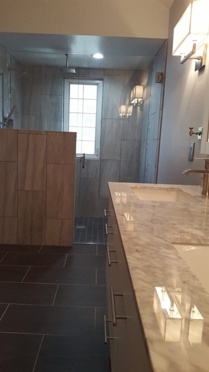Vertical tile place on walk in shower wall in Overland Park