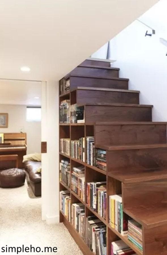 bookshelves under stairs