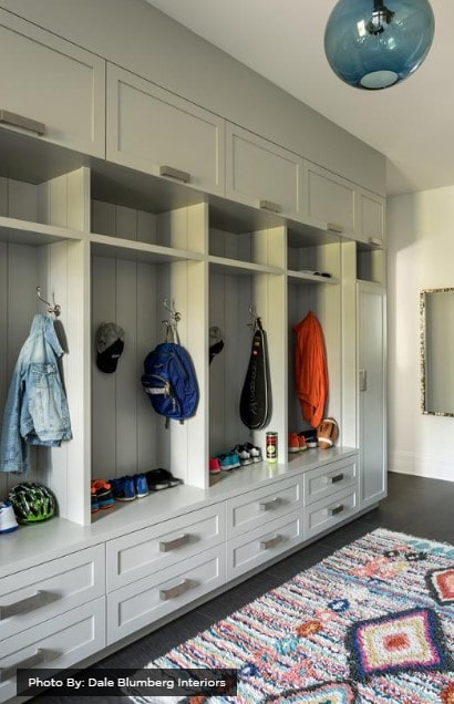 Mudroom with drawers and individual spaces for clothing