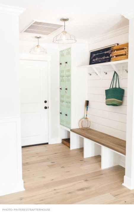 Mudroom with seating, coat racks and lockers