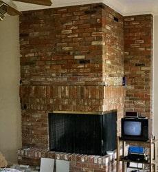 odd corner brick fireplace before