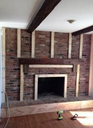 smooth wood fireplace before